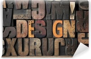 Abwaschbare Fototapete Das Wort 'DESIGN' in sehr alten Buchdruck-Blöcke geschrieben.