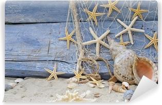Abwaschbare Fototapete Urlaubserinnerung: Posthornschnecke, Seesterne und Fischernetz