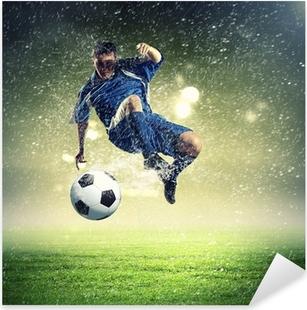 Adesivo Pixerstick Calciatore colpisce la palla