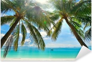Adesivo Pixerstick Island Paradise - palme appeso sopra una spiaggia di sabbia bianca