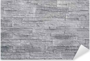 Adesivo Pixerstick Sfondo grigio muro di pietra. piastrelle di pietra  impilati vengono spesso utilizzati in ed92aea9f40b