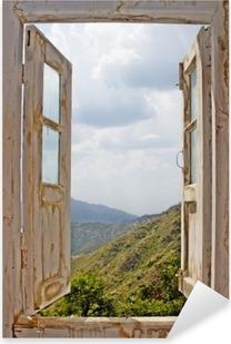 Adesivo Pixerstick Vista da una vecchia finestra bianca