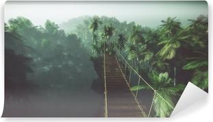 Afwasbaar Fotobehang Rope bridge in misty jungle with palms. Backlit.