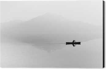 Fog over the lake. Silhouette of mountains in the background. The man floats in a boat with a paddle. Black and white Aluminium Print (Dibond)