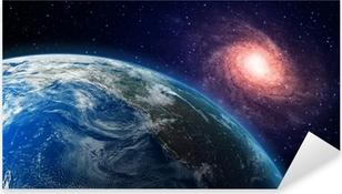 Pixerstick Aufkleber Erde und eine Spiralgalaxie im Hintergrund