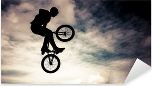 Pixerstick Aufkleber Silhouette eines Mannes, einen Sprung mit einem BMX-Fahrrad.