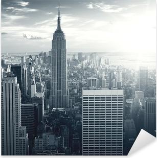 Autocolante Pixerstick Amazing view to New York Manhattan at sunset