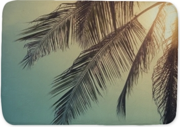 Top of palm tree with sun behind Bath Mat