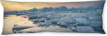 Frozen sea during sunset. Beautiful natural seascape in the winter time Body Pillow