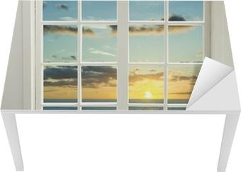 Bureau- en Tafelsticker Moderne venster woonwijken met zonsondergang over zee en wolken