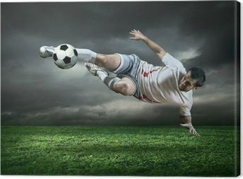 Canvas Football-speler met bal in actie onder regen buiten