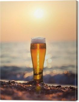 Canvas Glas bier op een zonsondergang