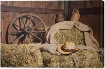 Canvas Interieur van een landelijke boerderij - hooi, wiel, cowboyhoed.