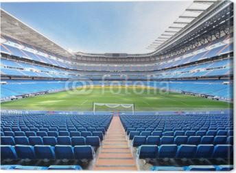 Canvas Lege outdoor voetbalstadion met blauwe zetels