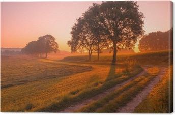 Canvas Oranje en Roze Zonsopgang boven Landelijk Landschap in de buurt van Nijmegen