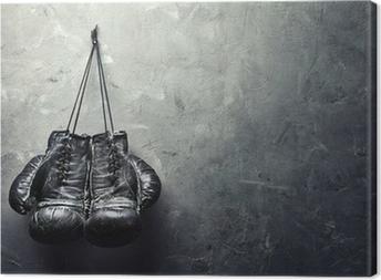 Canvas Oude bokshandschoenen hangen op spijker op textuurmuur