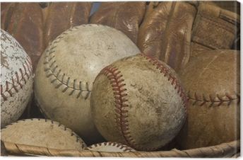 A Basket of Old Baseballs with an Antique Glove Canvas Print
