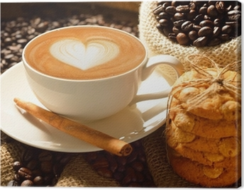 A cup of cafe latte with coffee beans and cookies Canvas Print