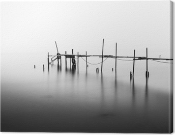 A Long Exposure of an ruined Pier in the Middle of the Sea.Processed in B&W. Canvas Print