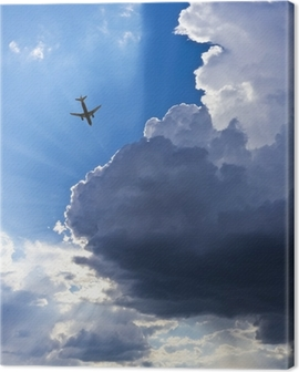 An Airliner, Blue Sky, Clouds and Sunbeams Canvas Print