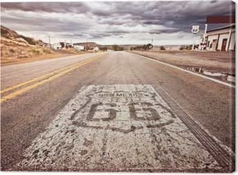An old Route 66 shield painted on road Canvas Print