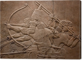 Ancient relief of assyrian warriors fighting in the war Canvas Print