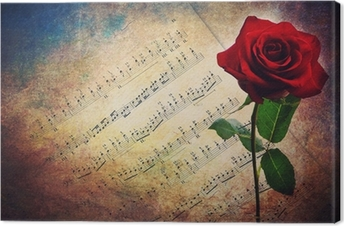 Antique musical score with red rose Canvas Print