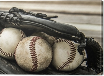 Baseball and mitt on rustic wooden background Canvas Print