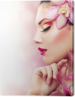 Beautiful Girl With Orchid Flowers. Perfect Make-up Canvas Print