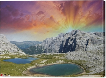 Beautiful lakes and peaks of Dolomites. Summer sunset over Alps Canvas Print