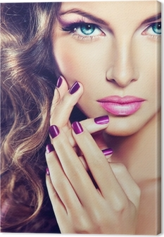 beautiful model with curly hair and purple manicure Canvas Print