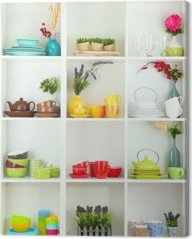 Beautiful white shelves with tableware and decor. Canvas Print