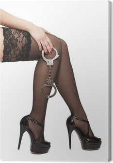 Beautiful woman legs in high heels and handcuffs Canvas Print