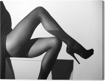 Black and white photo of beautiful legs in stockings Canvas Print