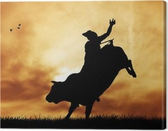Bull rider at sunset Canvas Print