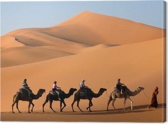 camel caravan in the sahara desert Canvas Print