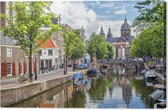Canal and St. Nicolas Church in Amsterdam Canvas Print