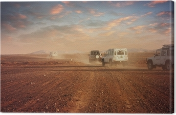 Cars in the desert at sunset Canvas Print