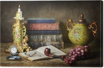 Classic still life with antiques,vintage books,old pipe, glasses,pocket watch and grapes on rustic wooden table. Canvas Print