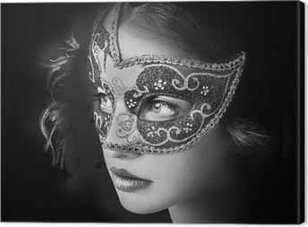 Close up portrait of woman in mysterious venetian mask Canvas Print