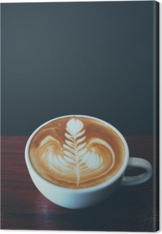 cup of coffee latte art in coffee shop Canvas Print