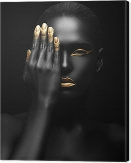 dark-skinned woman with golden make-up. Canvas Print