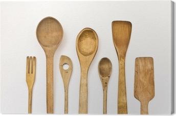 different kitchen wooden utensils on a white background Canvas Print