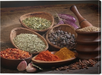Different spices over a wood background. Canvas Print