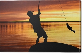 fisherman with a catching fish on sunrise background Canvas Print