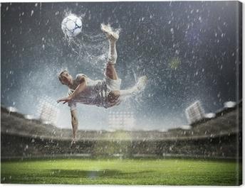 football player striking the ball Canvas Print