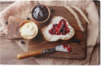 Fresh bread with homemade butter and blackcurrant jam Canvas Print