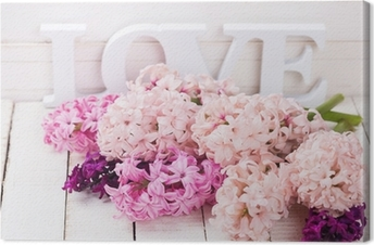 Fresh flowers and word love Canvas Print