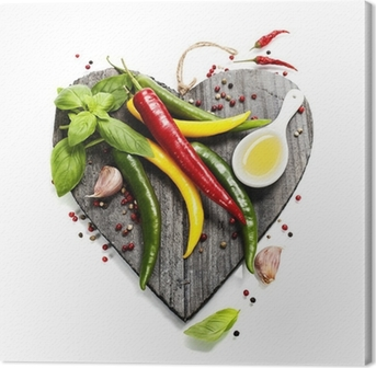 Fresh vegetables on heart shaped cutting board Canvas Print