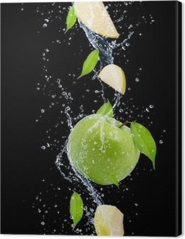 Green apples in water splash, isolated on black background Canvas Print